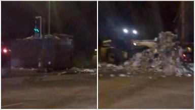 Rubbish pile: Lorry tipped over at roundabout in South Ayrshire.