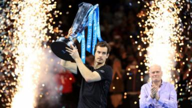 Champion: Andy Murray lifts the trophy in London.
