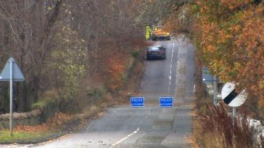 Dores Road: Man was walking near Holm roundabout.