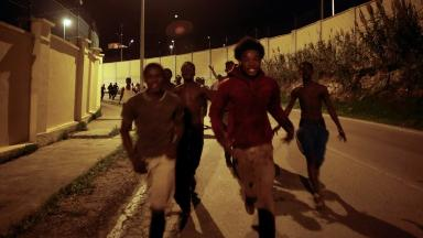 Hundreds of young men sprinted along the roads of Ceuta after crossing the border fence.