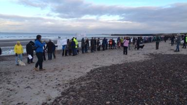 Protest: They gethered on a beach.