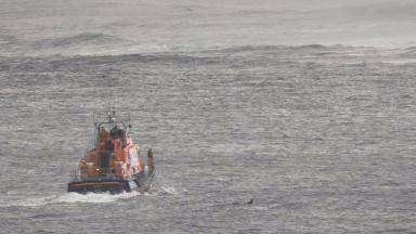 Rescue: Crew brought one surfer to shore.