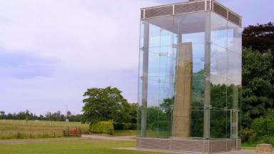 Sueno's Stone: Glass panels vandalised.
