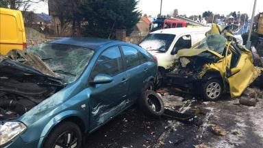 Guardbridge crash: Parked cars smashed by lorry.