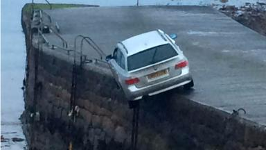 Mystery: Police are investigating how the car ended up on the edge of the pier.