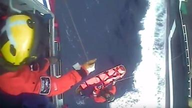 Rescue: Skipper airlifted to safety.