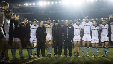 Celebrate: The Glasgow Warriors players embrace at full time.
