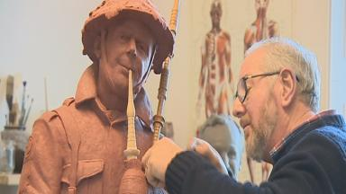 Statue: Alan Herriot puts the finishing touches to the piper.