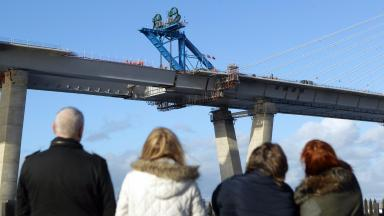 Crossing: The last section of the bridge being lifted into place.