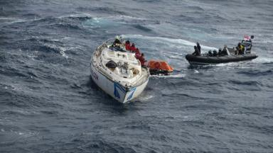 Racing yacht Clyde Challenger being rescued by crew of HMS Dragon.