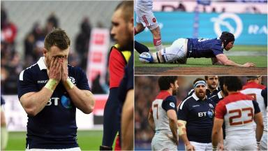 Dejection: Scotland spurned their chances in Paris.