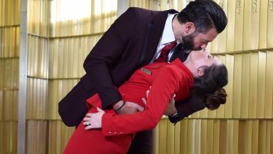 Gary Ogden, Flight Service Manager and his wife Jessie Ogden, Cabin Service Supervisor, recreate the iconic V-J Day kiss photograph at the new check-in area at Gatwick Airport North Terminal, to mark the launch of Virgin Atlantic's new kiss&fly service