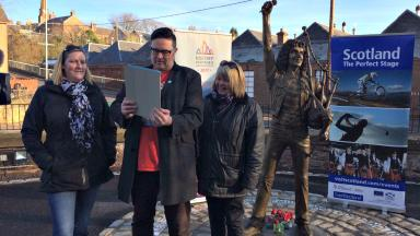 live link between the Bon Scott statue at his birthplace of Kirriemuir and the Bon Scott statue in Freemantle, Australia uploaded Friday February 17 2017