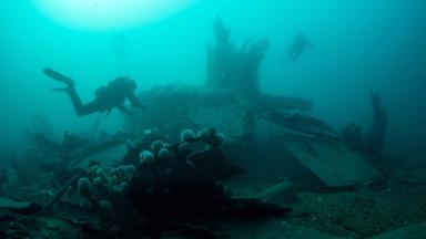Divers examining scrapped warships in in Scapa Flow, Orkney, in February 2017