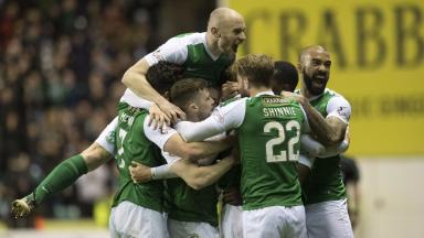Familiar foes: Hibs celebrate their win over Hearts in last season's competition.