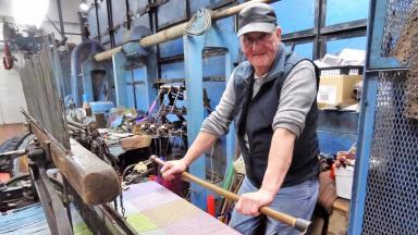 Carloway Mill weaver making Harris Tweed stock/generic image