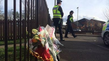 Floral tributes at scene of double stabbing in Drumlanrig Drive, Dundee