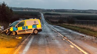Police van and car (right of shot) crash in Auchiries, Aberdeenshire