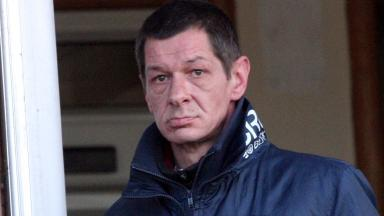 Alistair Gow admitted threat to blow up curry shop owner's family and racist tirade. Image from Central Scotland News Agency