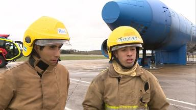 Carlos Poblete and Franki Alcaraz, south american firefighters training at edinburgh airport