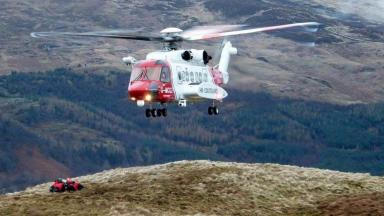 Coastguard helicopter in mountain rescue training exercise with Killin Mountain Rescue Team