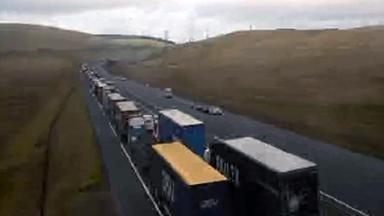 Delays after three-car crash on M74