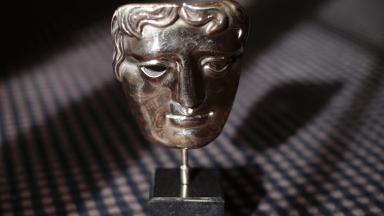 The Bafta mask.