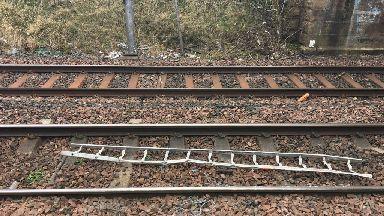 Ladder on train tracks