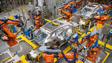 Robotic arms rivet car panels together in the Aluminium Body Shop, part of Jaguar Land Rover's Advanced Manufacturing Facility in Solihull, Birmingham