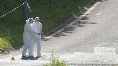 Steven Bonzo Daniel knife attack car chase near Craighall junction of M8 in Glasgow. Police forensic officers at scene of attempted murder.