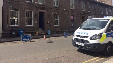 Death: A street has been cordoned off.