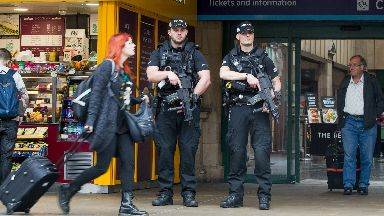 Armed police at Edinburgh's Waverley Train Station as travel hubs and other potential target areas have a heightened Police Scotland presence following the terrorist attack at Manchester Arena