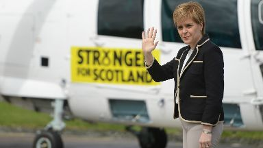 Scottish First Minister Nicola Sturgeon leaves Cumbernauld airport on her helicopter as she campaigns across Scotland including Hawick and Leven ahead of the general election. June 5, 2017.