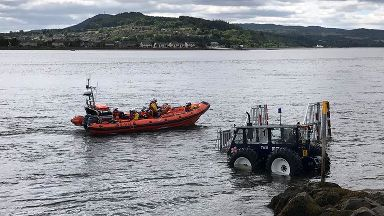 RNLI Kessock lifeboat returning to station following rescue of 2 sailors