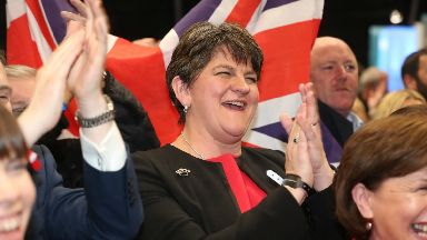 DUP leader Arlene Foster celebrates the election of Gavin Robinson in East Belfast at the Titanic exhibition centre in Belfast where counting is taking place in the 2017 General Election.