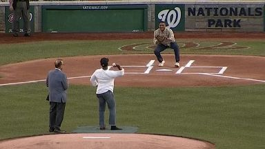 Hero cop injured in US baseball shooting throws first pitch at charity match
