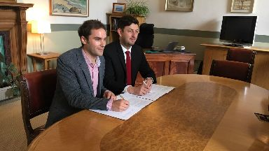 SNP's Adam McVey and Labour's Cammy Day sign coalition deal for Edinburgh city council.