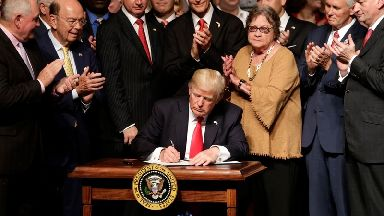 Donald Trump signs an executive order on a revised Cuba policy.