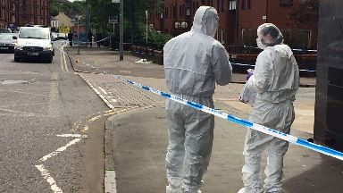 Forensics officers at scene of mass brawl stabbing on Hathaway Street in Maryhill, Glasgow, on 17/06/17
