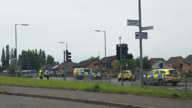 Crookston Road: A cordon has been put in place following the crash.