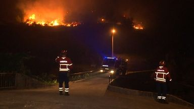 Fire crews battling to hold back the huge wildfire.