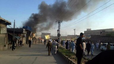 Photo taken with mobile phone shows smoke rises from a blast site in northwest Pakistan's Parachinar.