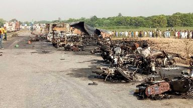 Burnt motorcycles lay near the oil tanker explosion.