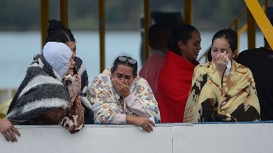 People cry as they wait for news of loved ones.