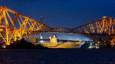 HMS Queen Elizabeth sailing along the Firth of Forth