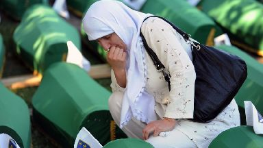 A woman mourns a relative killed in the massacre