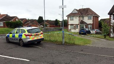 Property in Robroyston, Glasgow, where masked men raided house with firearm