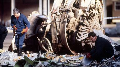 Police officers sifting through some of the wreckage of the Pan Am Boeing 747 which crashed in Lockerbie, killing all 258 on board and 17 people on the ground.