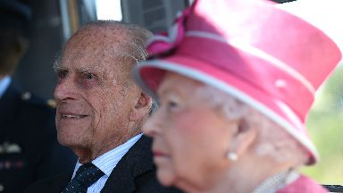 Queen Elizabeth II and the Duke of Edinburgh arrive by boat to visit The Kelpies sculpture near Falkirk to unveil a plaque to name the Queen Elizabeth II Canal that runs through the Helix development.