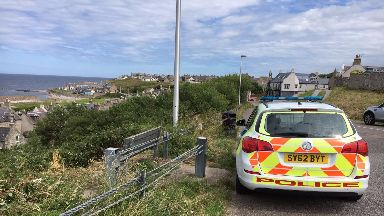 Land Street: A woman was found on flames in Buckie.